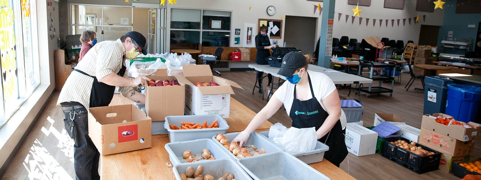 Image of a group of workers preparing food at the North Grove Community Centre in Dartmouth.